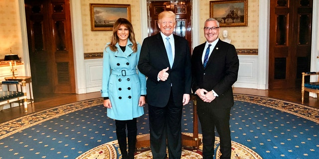 Attorney Michael Wildes with the president and first lady.
