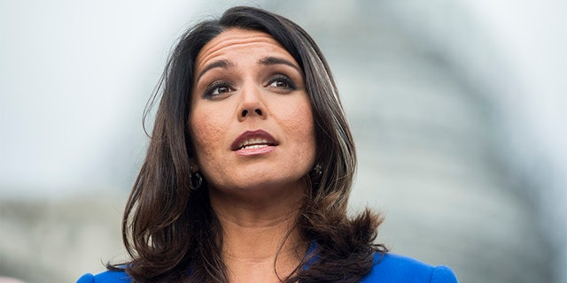 Rep. Tulsi Gabbard, D-Hawaii, speaks during a news conference.