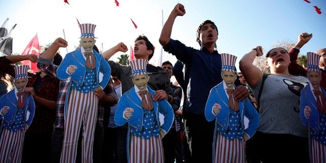 Nov. 15, 2015: Members of Turkey Youth Union hold effigies of U.S. President Barack Obama during a protest in Antalya, Turkey.