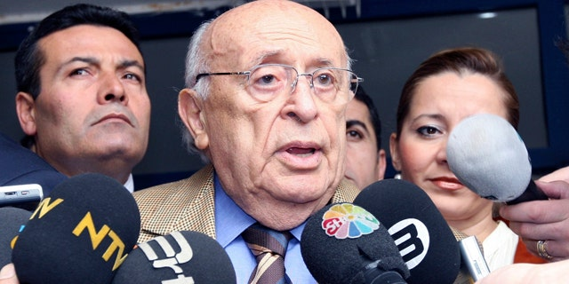 FILE - In this Oct. 21, 2007 file photo, former Turkish President Suleyman Demirel speaks to the media at a polling station in Ankara. Doctors at Guven Hospital said Demirel died Wednesday, June 17, 2015 of heart failure and a respiratory tract infection. He was 90. (AP Photo/Burhan Ozbilici, File)