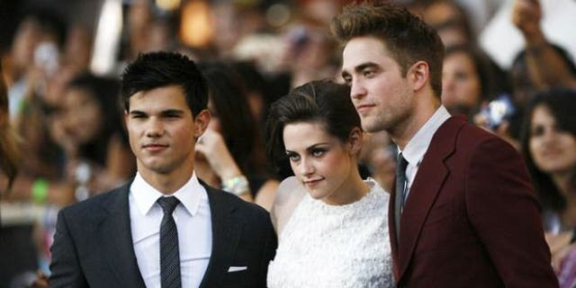 FILE: 'Twilight' stars Taylor Lautner, Kristen Stewart and Robert Pattinson pose for cameras at the premiere of the film.