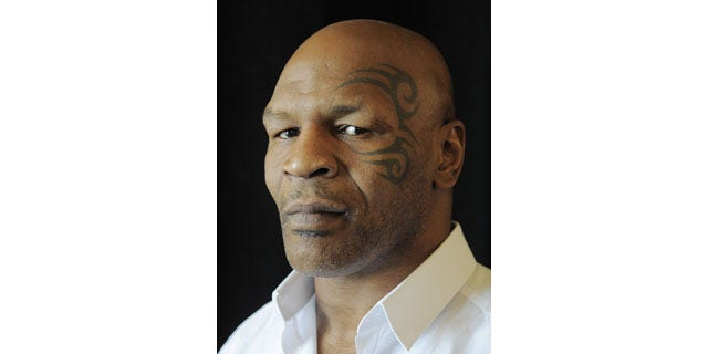 FILE - In this July 25, 2013, file photo, boxer MIke Tyson poses backstage during HBO's Summer 2013 TCA panel at the Beverly Hilton Hotel in Beverly Hills, Calif. (AP Photo)