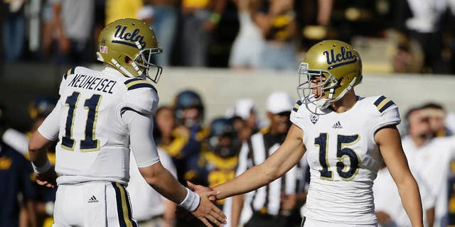 UCLA place kicker Ka'imi Fairbairn, right is greeted by holder Jerry Neuheisel, left, after kicking his third field goal of the game during the fourth quarter of a NCAA college football game against California Saturday, Oct. 18, 2014, in Berkeley, Calif. UCLA won the game 36-34. (AP Photo/Eric Risberg)