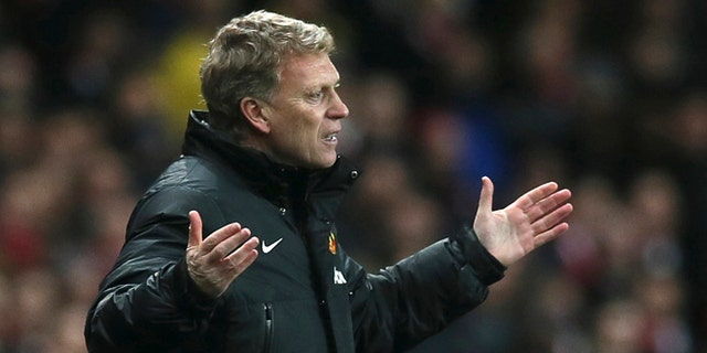 """FILE - In this Wednesday, Feb. 12, 2014 file photo Manchester United's manager David Moyes gestures to his team during their English Premier League soccer match between Arsenal and Manchester United at the Emirates stadium in London. Manchester United says manager David Moyes has left the Premier League club after less than a year in charge, amid heavy speculation he was about to be fired. United released a brief statement in its website Tuesday, saying the club """"would like to place on record its thanks for the hard work, honesty and integrity he brought to the role."""" (AP Photo/Alastair Grant, File)"""