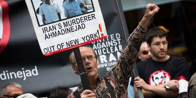 Sept. 24, 2012: Osborn Holmstrand of Sweden, chants during an anti-Mahmoud Ahmadinejad protest near the Warwick hotel in New York.