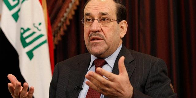 FILE - In this Dec. 3, 2011, file photo, Iraq's Shiite Prime Minister Nouri al-Maliki talks during an interview with The Associated Press in Baghdad, Iraq. (AP Photo/Hadi Mizban, File)