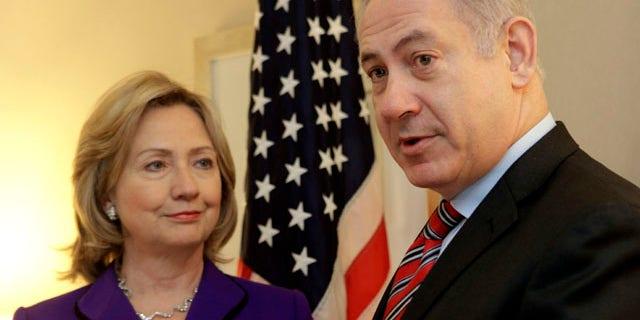 Nov. 11: U.S. Secretary of State Hillary Rodham Clinton, left, listens as Israeli Prime Minister Benjamin Netanyahu speaks to reporters during a meeting in New York.