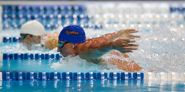 June 25, 2012: Ryan Lochte, right, and Michael Phelps compete in the men's 400-meter individual medley final at the U.S. Olympic swimming trials in Omaha, Neb.