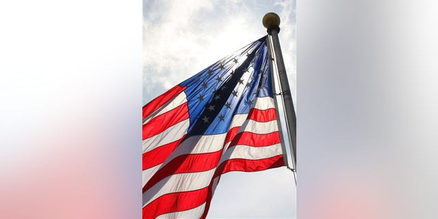 A flag flies in the breeze at the U.S. Flag Plaza at Liberty State Park in Jersey City, N.J. on Monday. June 13, 2011.  Flag Day is Tuesday, June 14. (AP Photo/The Jersey Journal, Pamela Suchy)