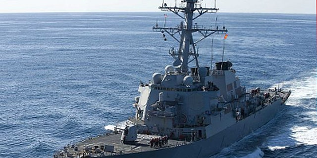 Dec. 5, 2010: The guided-missile destroyer USS John S. McCain approaches the aircraft carrier USS George Washington for a fueling at sea.