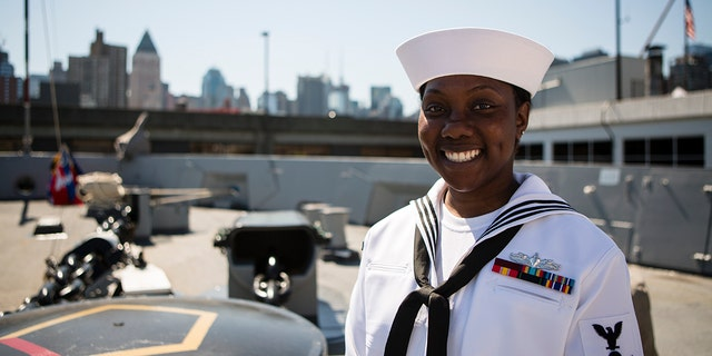 Nikita Antoine, who grew up in Brooklyn and is now an electrician's mate on the USS Arlington, says the '9/11 attack really showed how New York comes together'.