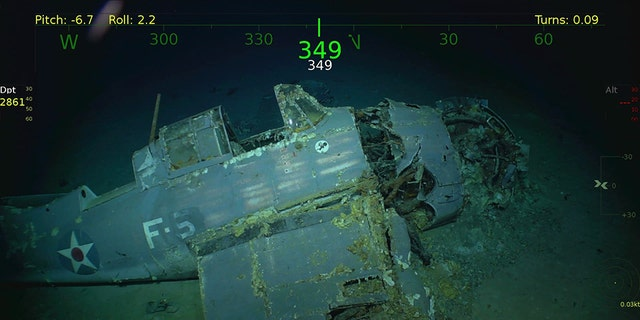 An aircraft from the USS Lexington rests on the bottom of the Coral Sea near Australia. The expedition crew of billionaire Paul Allen found the ship below 76 years after sinking.