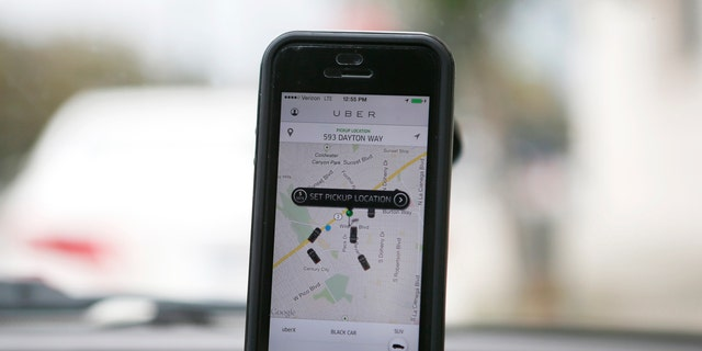 An Uber app is seen on an iPhone in Beverly Hills, California, December 19, 2013.