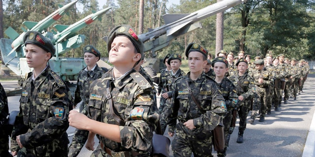 September 9, 2014: Students march during a military training exercise in a military school in Boyarka, near Kiev, Ukraine. (AP Photo/Efrem Lukatsky)