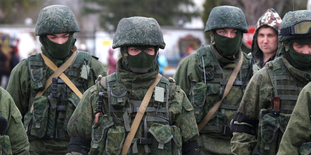 March 4, 2014: Pro Russian soldiers guard Ukraine's infantry base in Perevalne, Ukraine. Russian President Vladimir Putin said Moscow reserves the right to use all means to protect Russians in Ukraine as U.S. Secretary of State John Kerry was on his way to Kiev. Tensions remained high in the strategic Ukrainian peninsula of Crimea with troops loyal to Moscow firing warning shots to ward off protesting Ukrainian soldiers. (AP/Sergei Grits)