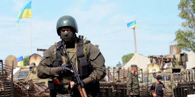 Ukrainian servicemen are pictured at the military camp near the town of Svyatogorsk in Eastern Ukraine, June 20, 2014.