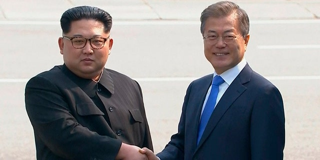North Korean leader Kim Jong Un, left, shakes hands with South Korean President Moon Jae-in as Kim crossed the border into South Korea for their historic face-to-face talks, in Panmunjom.