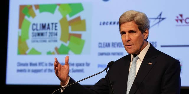 U.S. Secretary of State John Kerry delivers remarks at a NYC Climate Week opening event, at the Morgan Library in New York, Monday, Sept. 22, 2014. (AP Photo/Richard Drew)