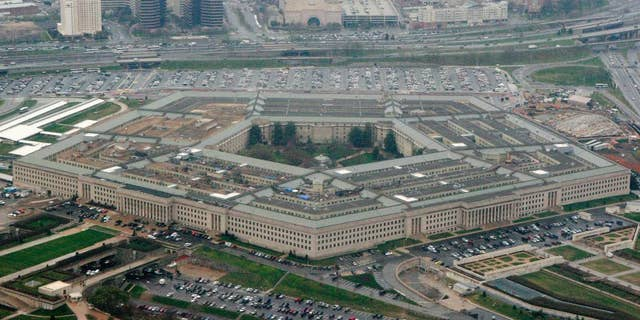"""FILE - This March 27, 2008, aerial file photo shows the Pentagon in Washington. The U.S. is protesting an intercept of a U.S. reconnaissance plane by a Russian fighter jet last week, calling it """"unsafe and unprofessional"""" amid what it views as increasingly aggressive air operations by Moscow. Pentagon spokesman Mark Wright on Sunday, April 12, 2015, said the U.S. was filing a complaint to Russia after the April 7 incident over the Baltic Sea. (AP Photo/Charles Dharapak, File)"""