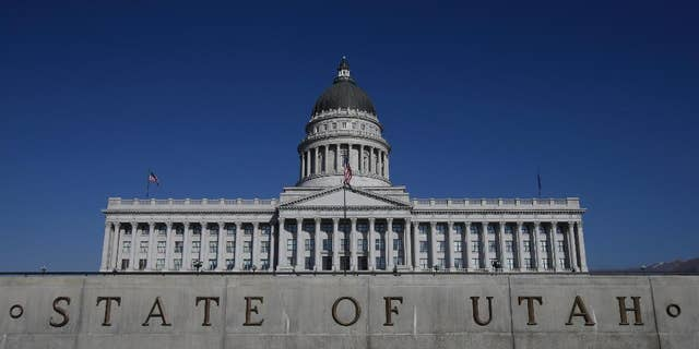 """FILE - In this Jan. 26, 2015, file photo, shows the Utah State Capitol, in Salt Lake City. Utah became the only state to allow firing squads for executions Monday, March 23, 2015, when Gov. Gary Herbert signed a law approving the controversial method's use when no lethal-injection drugs are available. Herbert has said he finds the firing squad """"a little bit gruesome,"""" but Utah is a capital punishment state and needs a backup execution method in case a shortage of the drugs persists. (AP Photo/Rick Bowmer, File)"""