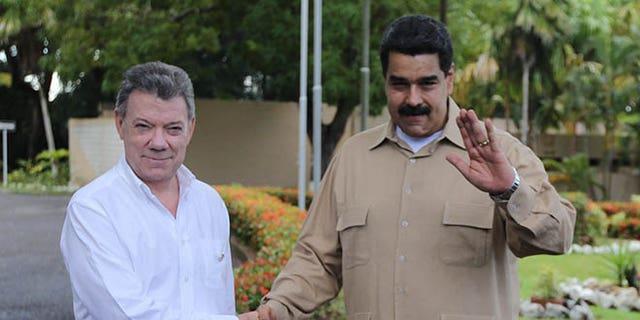 Venezuela's President Nicolas Maduro, right, and Colombian counterpart Juan Manuel Santos, in Puerto Ordaz, Venezuela, Thursday, Aug. 11, 2016.