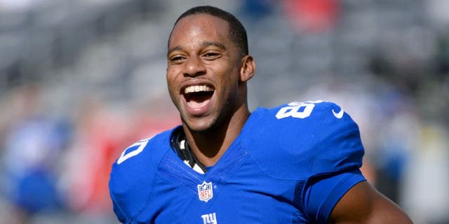 Sep 15, 2013; East Rutherford, NJ, USA; New York Giants wide receiver Victor Cruz (80) smiles before the game against the Denver Broncos at MetLife Stadium. Mandatory Credit: Robert Deutsch-USA TODAY Sports