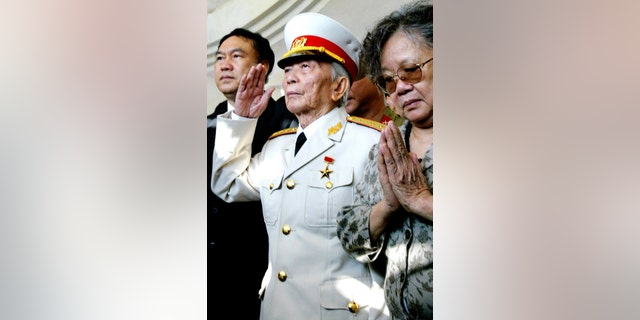 April 18, 2004 - FILE photo of Gen. Vo Nguyen Giap saluting his fallen comrades at a shrine of the Dien Bien Phu's war cemetery in Dien Bien Phu, Vietnam. Giap, the military mastermind who drove the French and Americans out of Vietnam, died at a Hanoi hospital Friday at age 102.