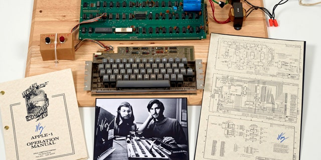 "This undated photo provided by Christie's Auction House shows an ""Apple 1"" prototype computer, built in 1976, accompanied by an operation manual and schematic as well as a photo of its inventors, Steve Wozniak, left, and Steve Jobs."