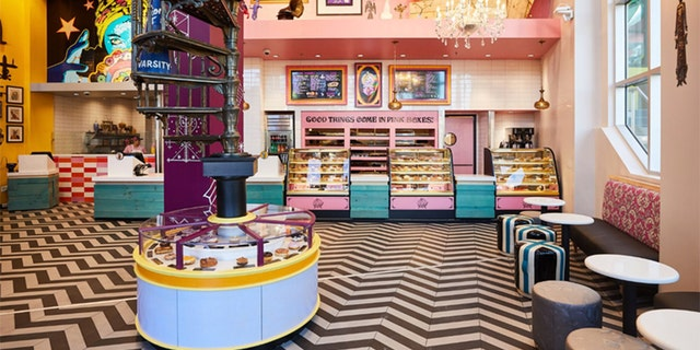 The new shop features Voodoo's signature eclectic look, including bright pink accents and a black and white zig zag-patterned floor.