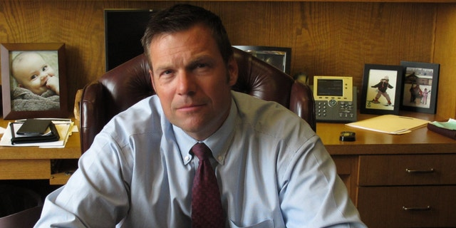 Kansas Secretary of State Kris Kobach, the architect of the state's proof-of-citizenship law for new voters, in Aug. 1, 2013.