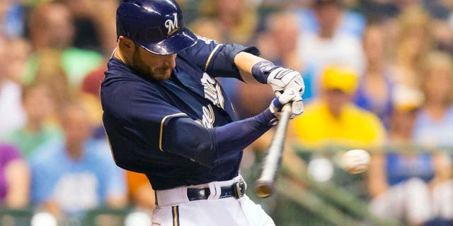 Tuesday, Sept. 1: Milwaukee Brewers catcher Jonathan Lucroy hits a RBI single during the second inning against the Pittsburgh Pirates at Miller Park.