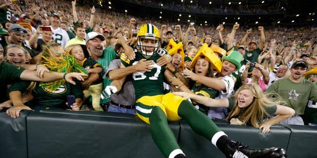 Friday, August 22: Green Bay Packers wide receiver Jordy Nelson celebrates with fans after scoring a touchdown against the Oakland Raiders.