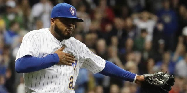 Friday, May 13, 2016: Milwaukee Brewers relief pitcher Jeremy Jeffress celebrates after getting San Diego Padres' Brett Wallace out to end the ninth inning in Milwaukee. The Brewers won 1-0.