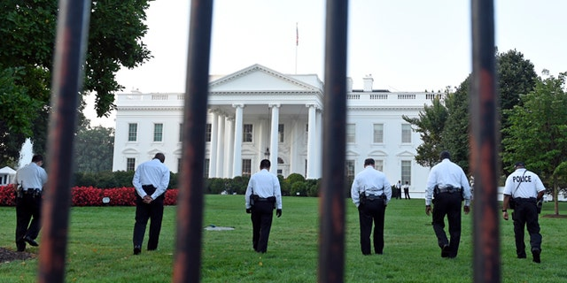 Sept. 20, 2014: Uniformed Secret Service officers walk along the lawn on the North side of the White House in Washington, D.C.