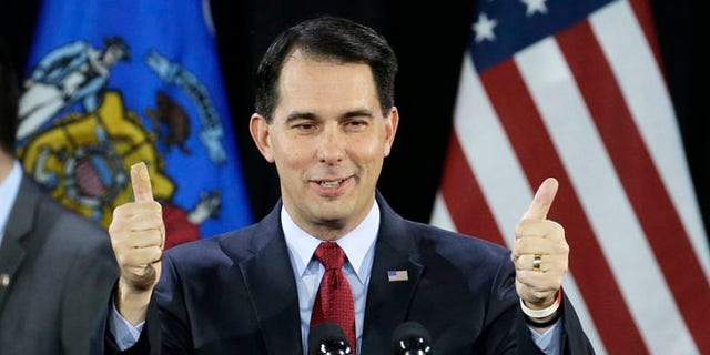 FILE: Nov. 4, 2014: Wisconsin GOP Gov. Scott Walker at his re-election victory party, in West Allis, Wis.