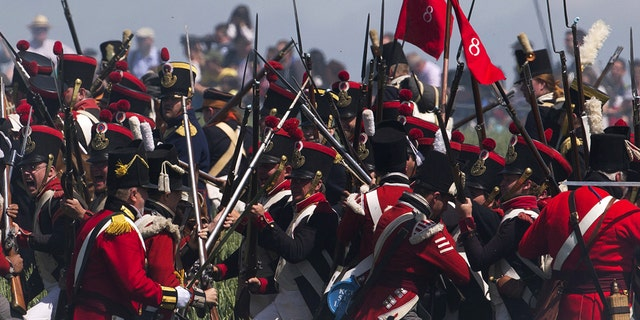 File photo - Performers take part in the re-enactment of the battle of Ligny, during the bicentennial celebrations for the Battle of Waterloo, in Ligny, Belgium, June 14, 2015.