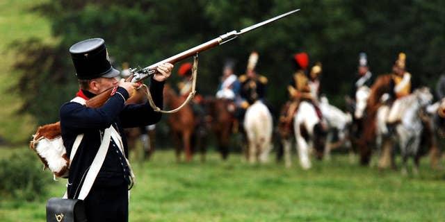 Actors dressed as soldiers re-enact the Battle of Waterloo in Braine-l'Alleud, near Waterloo, Belgium.