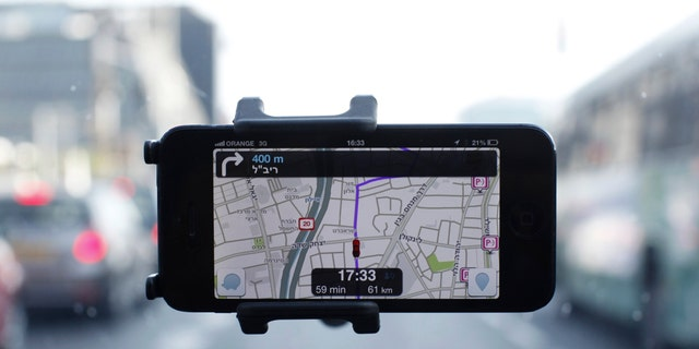 The Waze application is seen on a smartphone in this photo illustration taken in Tel Aviv May 9, 2013.