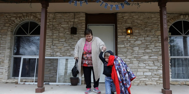Mary-Jane Harrison plays with her grandson David, in San Antonio. Like nearly 78 million American adults, Harrison is obese, and because of stress fractures in her legs she is unable to able to walk up or down the stairs of her two-story home. (AP Photo/Eric Gay)