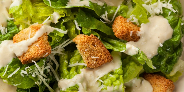 Healthy Green Organic Caesar Salad with Cheese and Croutons