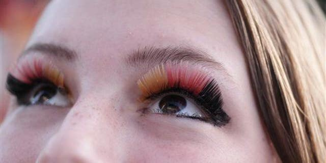 A woman with painted eyelashes in Germany, on Monday, June 30, 2014.