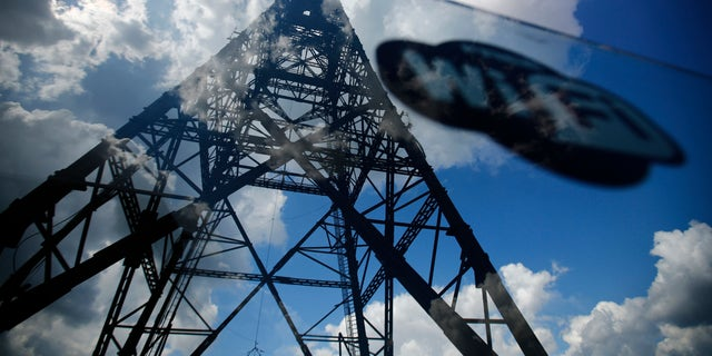 A sticker with Wifi sign is seen on a glass fence around Gliwice radio tower, Europe's tallest wooden structure, at Gliwice radio station in Upper Silesia, southern Poland.