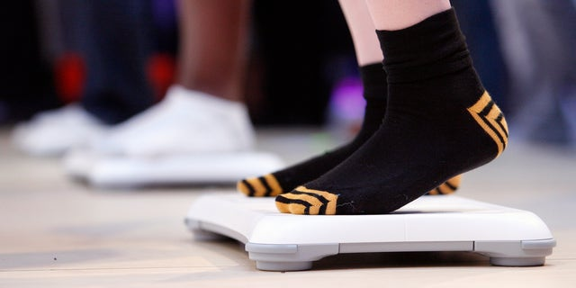 June 2, 2009: Visitors step on Nintendo Wii Balance Boards as they play the new Wii Fit Plus game during the Electronic Entertainment Expo or E3 in Los Angeles.