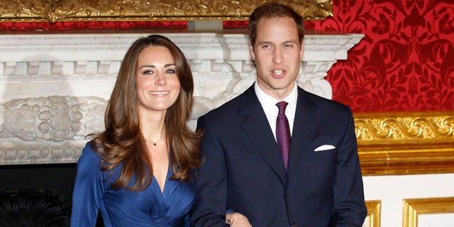 Britain's Prince William and his fiancee Kate Middleton (L) pose for a photograph in St. James's Palace, central London November 16, 2010. Britain's Prince William is to marry his long-term girlfriend Kate Middleton next year, after an on-off courtship lasting nearly a decade, bringing months of speculation about his intentions to an end.    REUTERS/Suzanne Plunkett   (BRITAIN - Tags: ENTERTAINMENT SOCIETY ROYALS) - RTXUPLP
