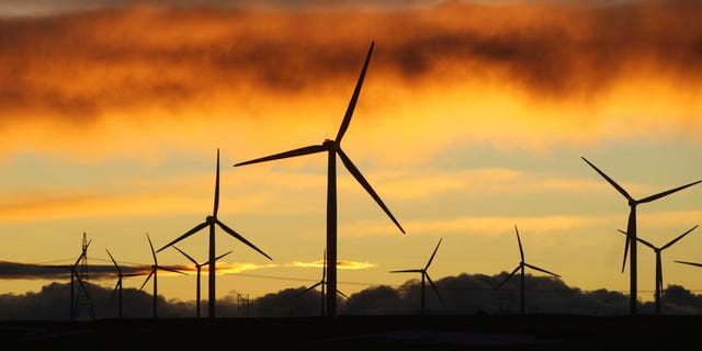 Jan. 19: Clouds turn orange and purple as the sun sets behind the Happy Jack Wind Farm east of Cheyenne, Wyo. Wyoming wind energy developers are holding promotional events in Cheyenne and Casper this week to highlight the positives of the new industry as it works to carve out a place for itself in the state. (AP)