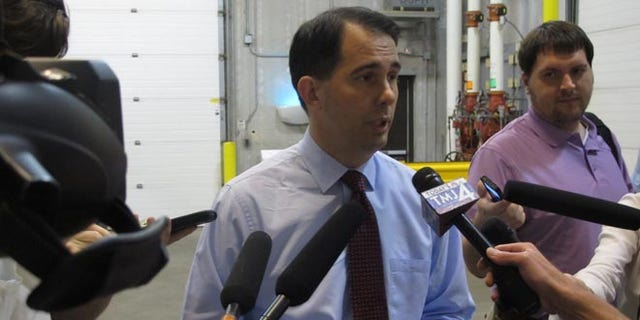 Gov. Scott Walker speaks to reporters in Madison, Wis. on Thursday, June 26, 2014.