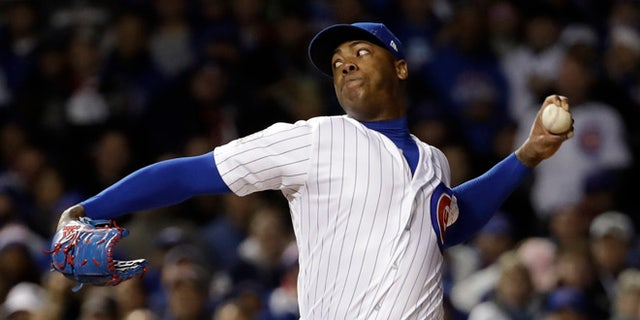 Chicago Cubs relief pitcher Aroldis Chapman throws during the seventh inning of Game 5 of the Major League Baseball World Series =ai-Sunday, Oct. 30, 2016, in Chicago. (AP Photo/David J. Phillip)