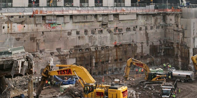 FILE: Construction workers and equipment excavate the southeastern corner of the World Trade Center site.