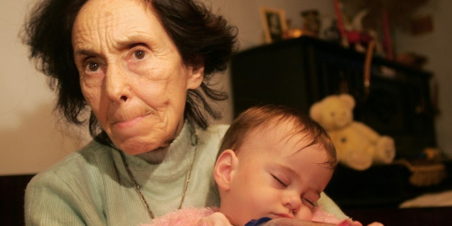Adriana Iliescu, 67, holds her one-year-old daughter Eliza-Maria in her apartment in Bucharest, Romania January 16, 2006. Doctors said that one year ago, the 66-year-old Romanian woman was the world's oldest recorded woman to give birth. Iliescu, an university professor and author of children's books, gave birth after doctors used in vitro fertilization and the sperm and eggs from younger people, an act slammed by the Romanian Orthodox Church as 'selfish' and which stirred debate in the local press.