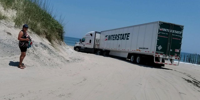 Currituck County Sheriff Matt Beickert said the driver was attempting to make a U-turn on the beach when the vehicle got stuck.